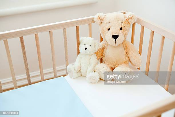 Teddy bears on crib