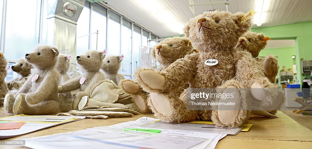 Teddy bears sit on a table at the Steiff stuffed toy factory on November 23, 2012 in Giengen an der Brenz, Germany. Founded by seamstress Margarethe Steiff in 1880, Steiff has been making stuffed teddy bears since the early 20th century ever since her nephew Richard Steiff exhibited the first commercially produced teddy bear in Europe in 1903. Teddy bears are among the most popular children's toys and the company is hoping for a strong Christmas season.