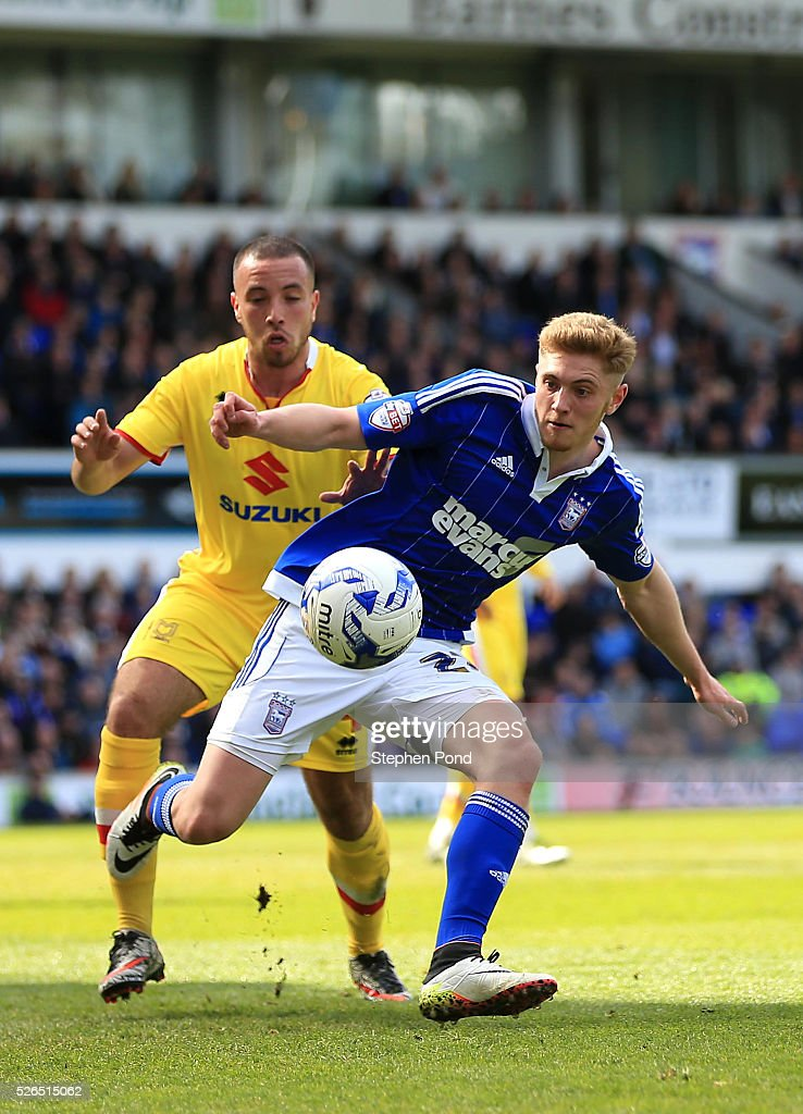 Teddy Bishop of Ipswich Town and Samir Carruthers of MK Dons compete for the ball during the Sky Bet Championship match between Ipswich Town and Milton Keynes Dons at Portman Road on April 30, 2016 in Ipswich, England.