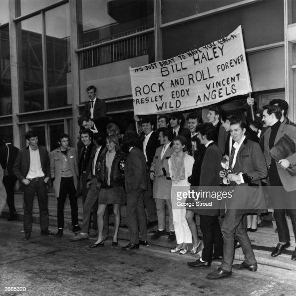 Teddy Boys and girls at London Airport to greet rock and roll singer Bill Haley