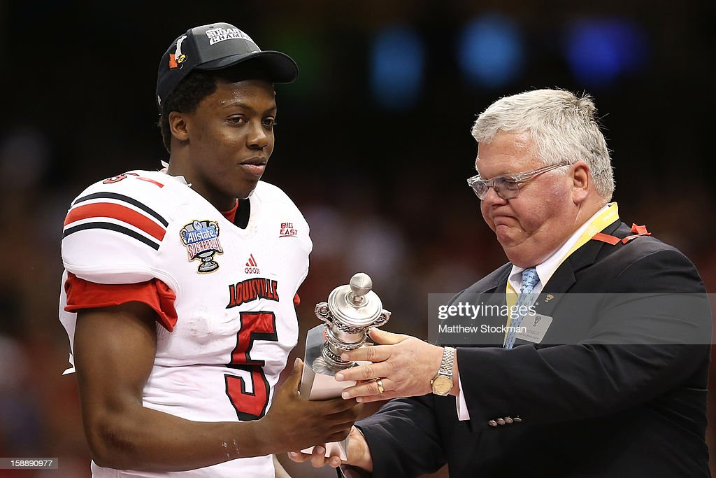 Teddy Bridgewater #5 of the Louisville Cardinals accepts the Most Outstanding Player award after their 33 to 23 win over the Florida Gators in the Allstate Sugar Bowl at Mercedes-Benz Superdome on January 2, 2013 in New Orleans, Louisiana.