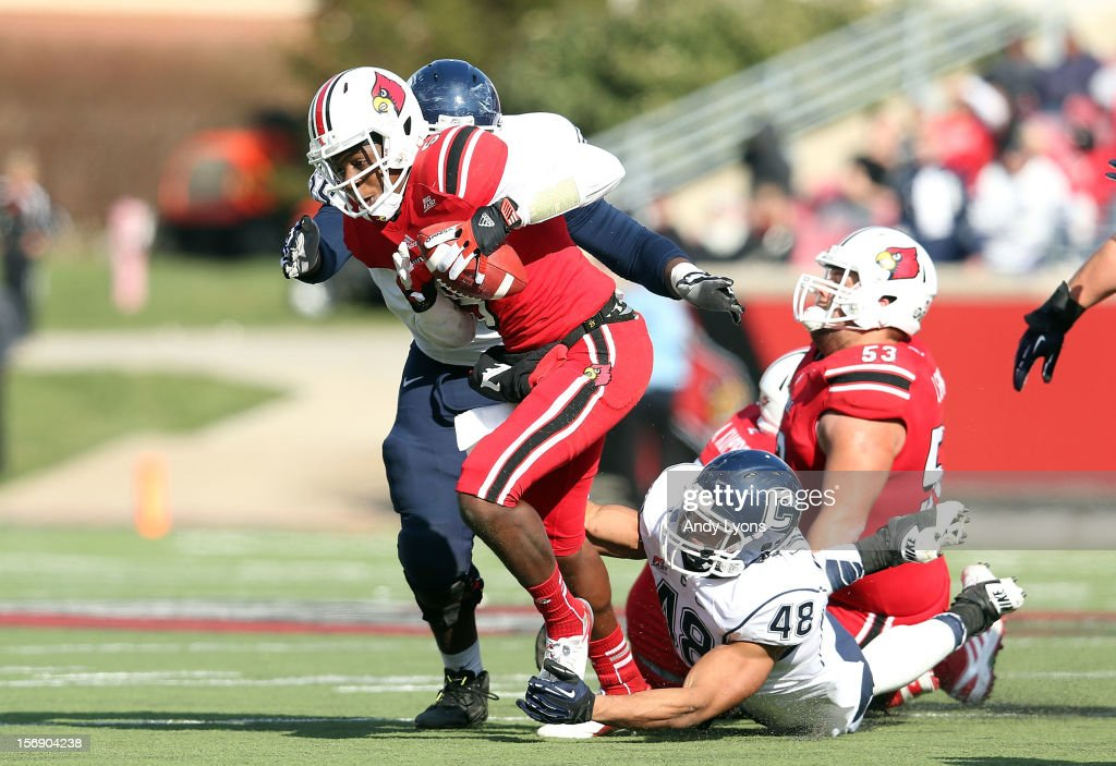 <a gi-track='captionPersonalityLinkClicked' href=/galleries/search?phrase=Teddy+Bridgewater&family=editorial&specificpeople=8281522 ng-click='$event.stopPropagation()'>Teddy Bridgewater</a> of the Louisville Cardinals is sacked by Shamar Stephen #59 and Trevardo Williams #48 of the Connecticut Huskies at Papa John's Cardinal Stadium on November 24, 2012 in Louisville, Kentucky.