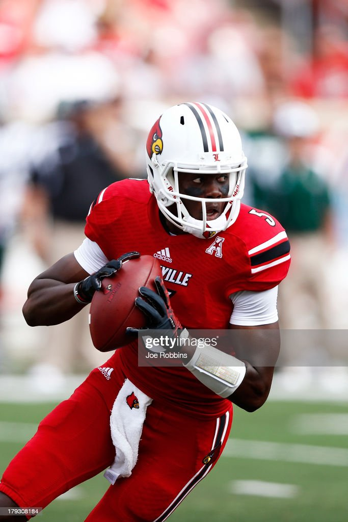 Teddy Bridgewater #5 of the Louisville Cardinals looks to pass the ball against the Ohio Bobcats during the game at Papa John's Cardinal Stadium on September 1, 2013 in Louisville, Kentucky.