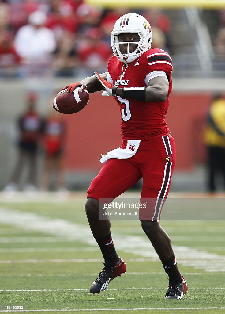 <a gi-track='captionPersonalityLinkClicked' href=/galleries/search?phrase=Teddy+Bridgewater&family=editorial&specificpeople=8281522 ng-click='$event.stopPropagation()'>Teddy Bridgewater</a> #5 of the Louisville Cardinals looks to throws a pass during the game against Florida International Panthers at Papa John's Cardinal Stadium on September 21, 2013 in Louisville, Kentucky.