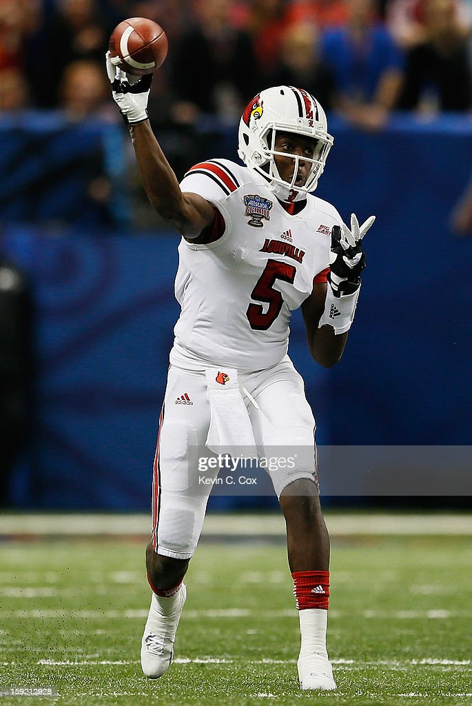 <a gi-track='captionPersonalityLinkClicked' href=/galleries/search?phrase=Teddy+Bridgewater&family=editorial&specificpeople=8281522 ng-click='$event.stopPropagation()'>Teddy Bridgewater</a> #5 of the Louisville Cardinals passes the ball against the Florida Gators during the Allstate Sugar Bowl at Mercedes-Benz Superdome on January 2, 2013 in New Orleans, Louisiana.