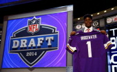 Teddy Bridgewater of the Louisville Cardinals poses with a jersey after he was picked overall by the Minnesota Vikings during the first round of the...