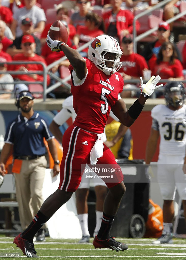 Teddy Bridgewater #5 of the Louisville Cardinals throws a pass during the game against Florida International Panthers at Papa John's Cardinal Stadium on September 21, 2013 in Louisville, Kentucky.