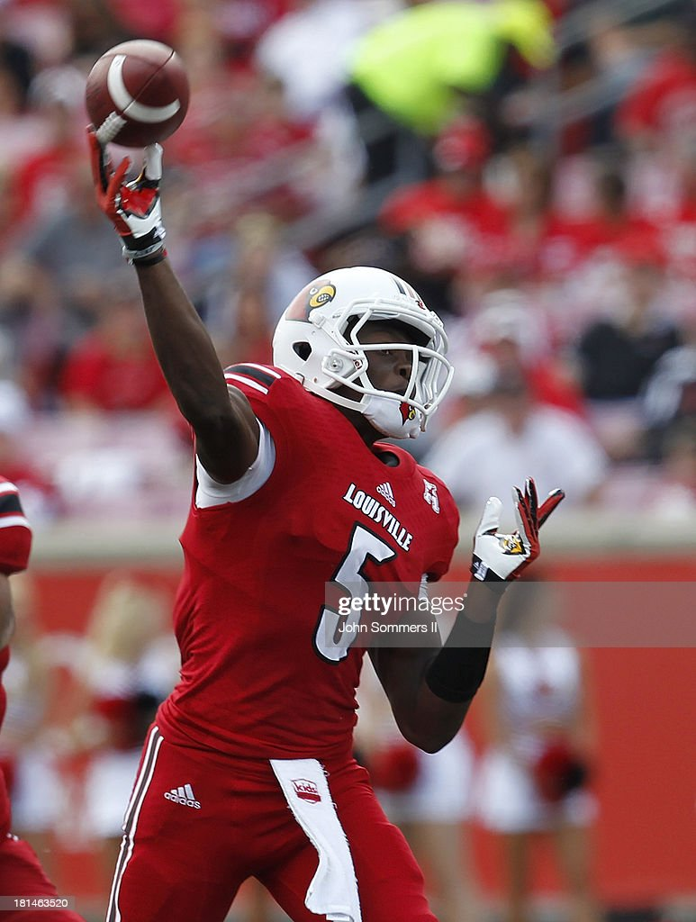 <a gi-track='captionPersonalityLinkClicked' href=/galleries/search?phrase=Teddy+Bridgewater&family=editorial&specificpeople=8281522 ng-click='$event.stopPropagation()'>Teddy Bridgewater</a> #5 of the Louisville Cardinals throws a pass during the game against Florida International Panthers at Papa John's Cardinal Stadium on September 21, 2013 in Louisville, Kentucky.