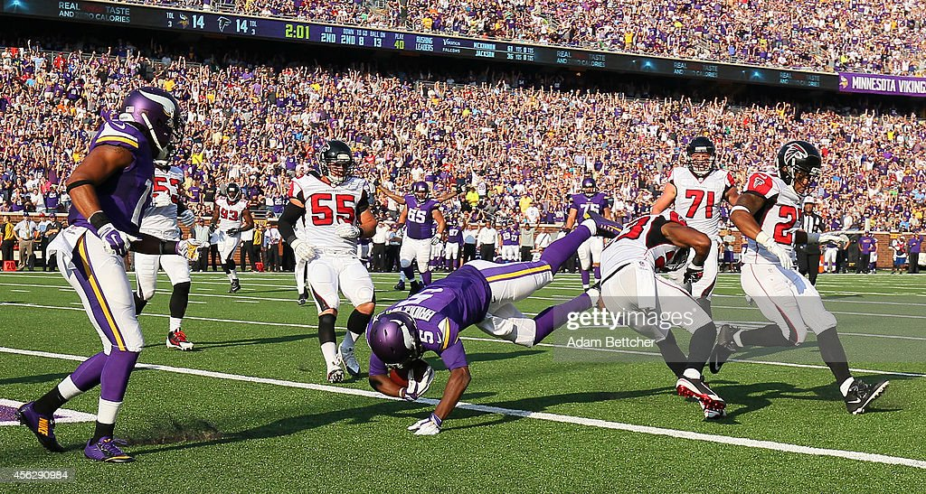 Teddy Bridgewater of the Minnesota Vikings dives into the end zone for a touchdown against the Atlanta Falcons on September 28 2014 at TCF Bank...