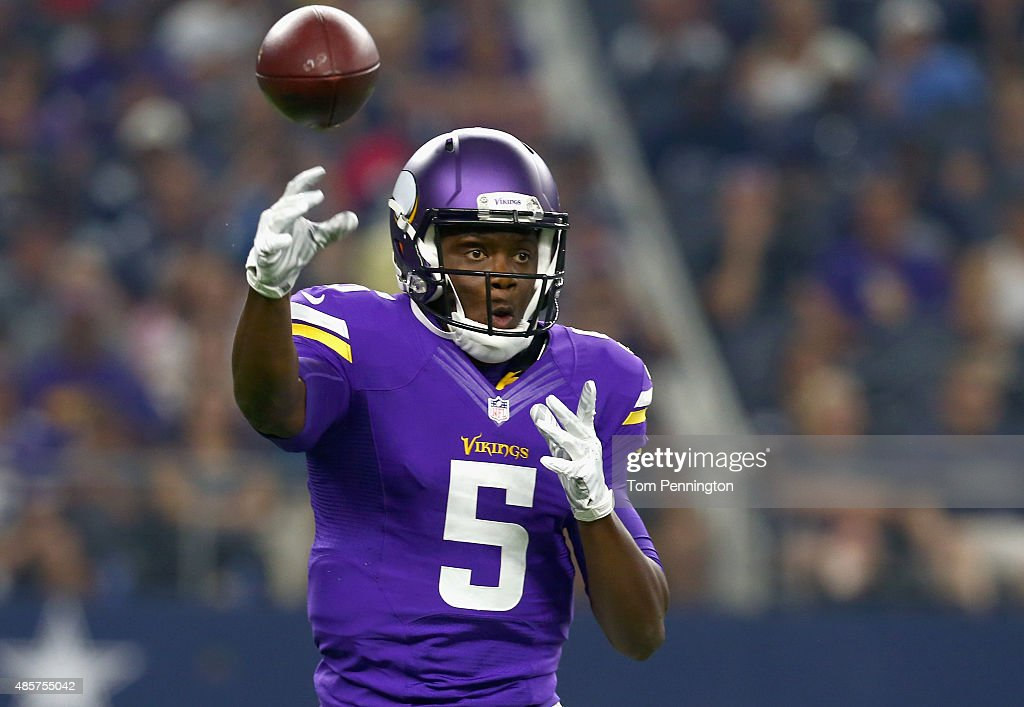 Teddy Bridgewater #5 of the Minnesota Vikings looks for an open receiver in the first quarter against the Dallas Cowboys on August 29, 2015 in Arlington, Texas.