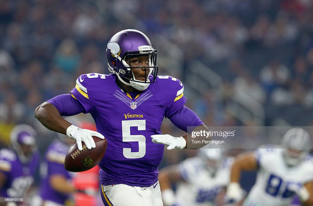 Teddy Bridgewater #5 of the Minnesota Vikings looks for an open receiver in the first quarter of a preseason game against the Dallas Cowboys on August 29, 2015 in Arlington, Texas.