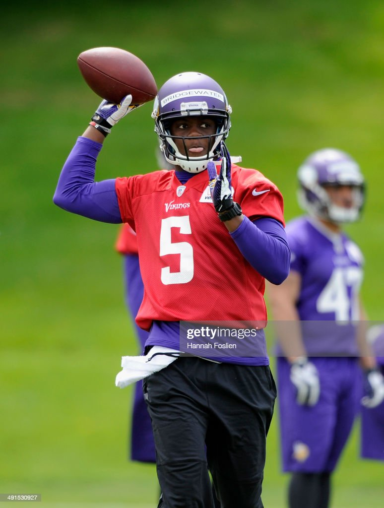 Teddy Bridgewater of the Minnesota Vikings runs a drill during rookie minicamp on May 16 2014 at Winter Park in Eden Prairie Minnesota