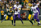 Teddy Bridgewater of the Minnesota Vikings stiff arms Clay Matthews of the Green Bay Packers during the second quarter of their game at Lambeau Field...