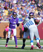 Teddy Bridgewater of the Minnesota Vikings throws the ball while teammate Matt Kalil blocks Nick Fairley of the Detroit Lions during the fourth...