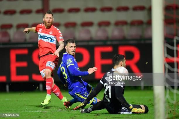 Teddy Chevalier forward of KV Kortrijk scores his goal in front of Dimitrios Goutas defender of STVV and Lucas Pirard goalkeeper of STVV during the...