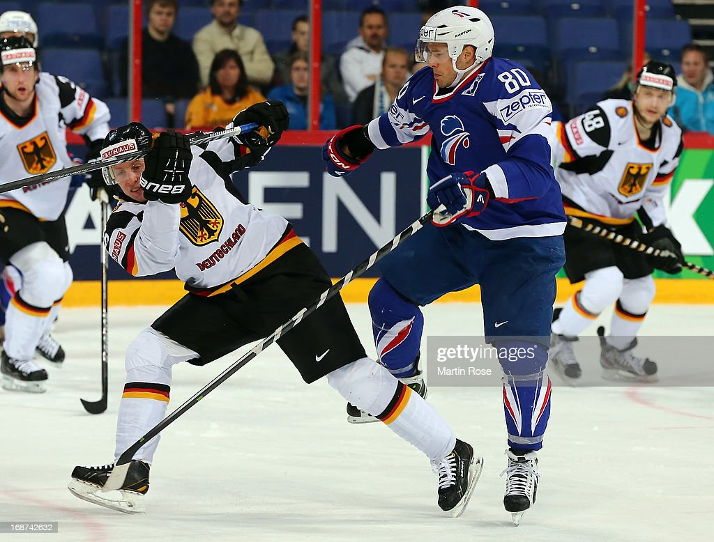 Teddy da Costa (R) of France checks Michael Wolf (L) of Germany during the IIHF World Championship group H match between France and Germany at Hartwall Areena on May 14, 2013 in Helsinki, Finland.