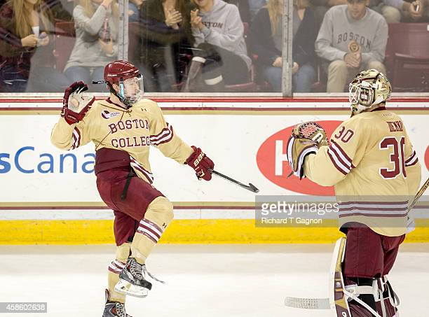 Teddy Doherty of the Boston College Eagles celebrates an Eagles goal with teammate Thatcher Demko during NCAA hockey against the Boston University...