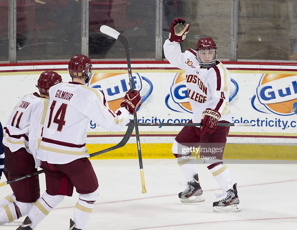Teddy Doherty #4 of the Boston College Eagles celebrates his second period goal with teammates Adam Gilmour #14 and Chris Calnan #11 during NCAA hockey action at Kelley Rink on December 6, 2013 in Chestnut Hill, Massachusetts.