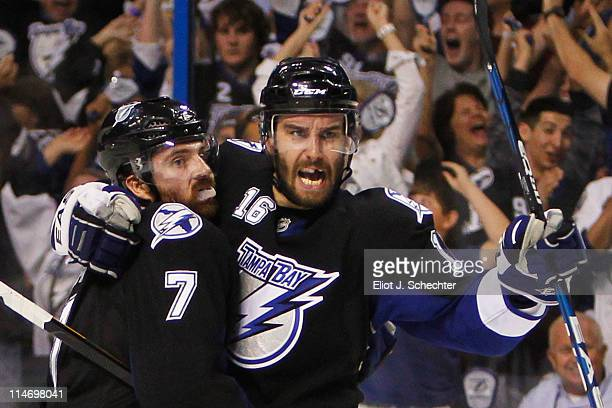 Teddy Purcell celebrates his second period goal with Brett Clark of the Tampa Bay Lightning in Game Six of the Eastern Conference Finals against the...