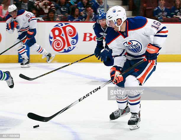 Teddy Purcell of the Edmonton Oilers skates up ice with the puck during their NHL game against the Vancouver Canucks at Rogers Arena October 11 2014...