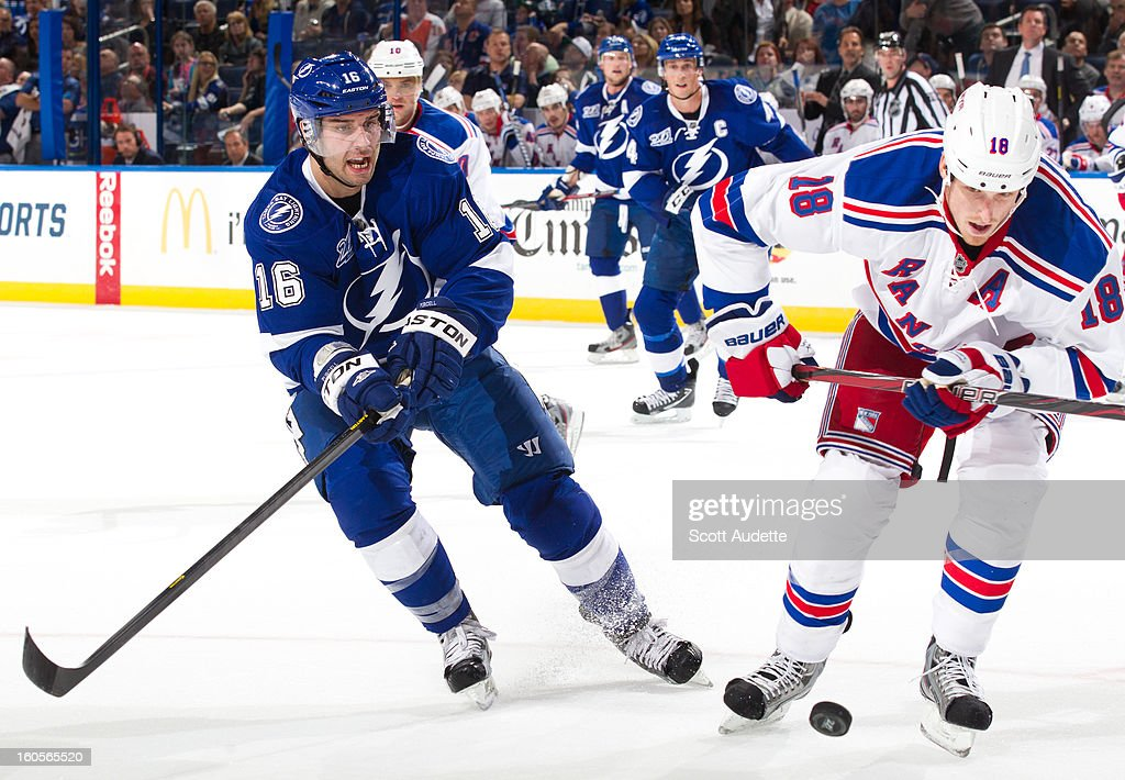 <a gi-track='captionPersonalityLinkClicked' href=/galleries/search?phrase=Teddy+Purcell&family=editorial&specificpeople=4537302 ng-click='$event.stopPropagation()'>Teddy Purcell</a> #16 of the Tampa Bay Lightning and <a gi-track='captionPersonalityLinkClicked' href=/galleries/search?phrase=Marc+Staal&family=editorial&specificpeople=3809026 ng-click='$event.stopPropagation()'>Marc Staal</a> #18 of the New York Rangers both try to gain control of the puck during the third period of their game at the Tampa Bay Times Forum on February 2, 2013 in Tampa, Florida.
