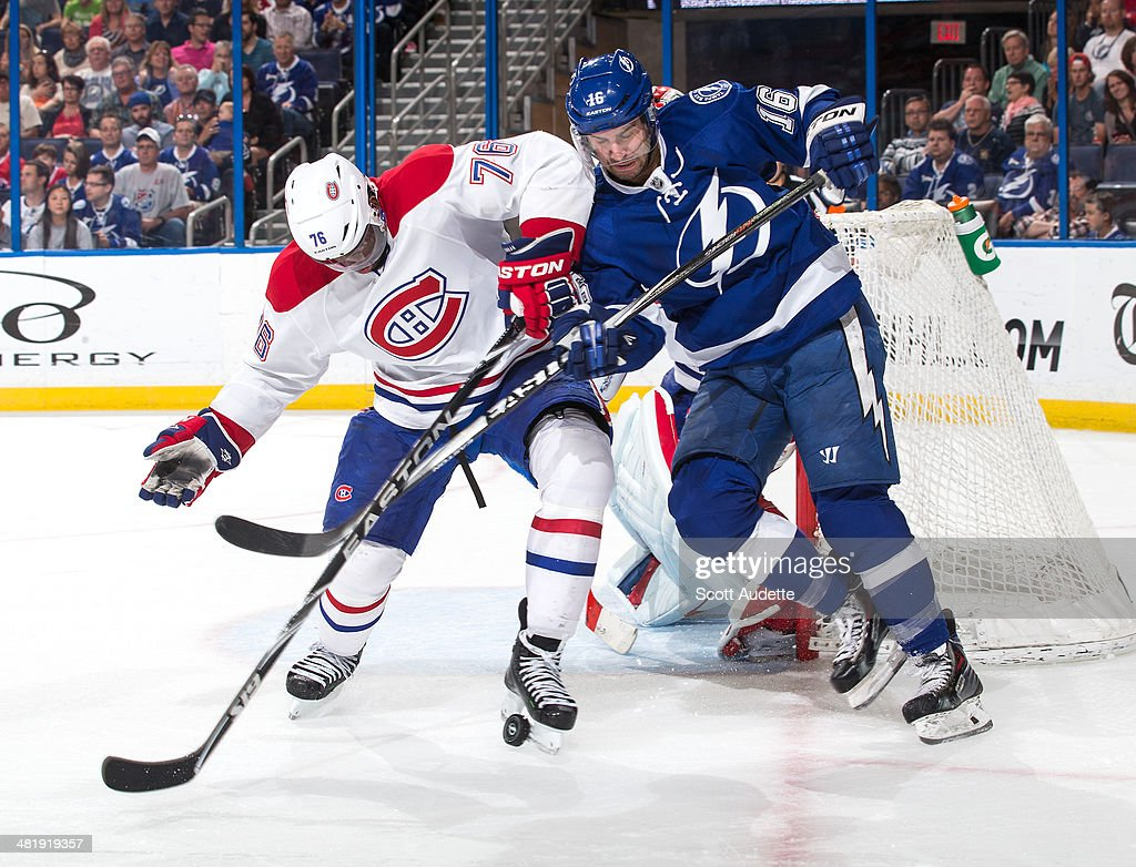 <a gi-track='captionPersonalityLinkClicked' href=/galleries/search?phrase=Teddy+Purcell&family=editorial&specificpeople=4537302 ng-click='$event.stopPropagation()'>Teddy Purcell</a> #16 of the Tampa Bay Lightning battles for the puck against <a gi-track='captionPersonalityLinkClicked' href=/galleries/search?phrase=P.K.+Subban&family=editorial&specificpeople=714418 ng-click='$event.stopPropagation()'>P.K. Subban</a> #76 of the Montreal Canadiens during the third period at the Tampa Bay Times Forum on April 1, 2014 in Tampa, Florida.