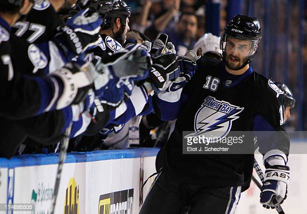 Teddy Purcell of the Tampa Bay Lightning celebrates his first period goal with teammates in Game Six of the Eastern Conference Finals against the...