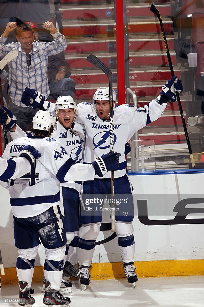 Teddy Purcell #16 of the Tampa Bay Lightning celebrates his goal to tie the game with teammate Steven Stamkos #91 against the Florida Panthers at the BB&T Center on February 16, 2013 in Sunrise, Florida.
