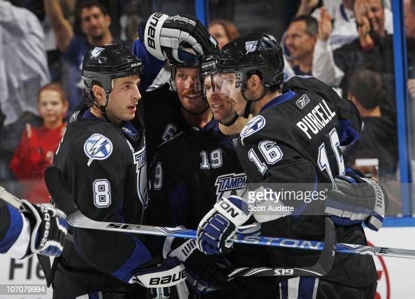 Teddy Purcell of the Tampa Bay Lightning celebrates his goal with teammates Randy Jones Dominic Moore and Ryan Malone during the second period...
