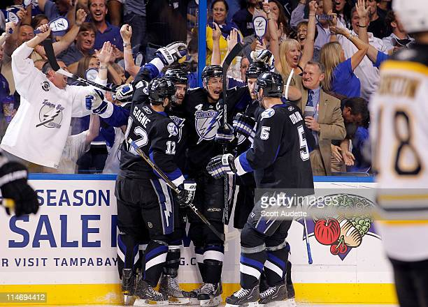 Teddy Purcell of the Tampa Bay Lightning celebrates his goal with teammates during the first period against the Boston Bruins in Game Six of the...