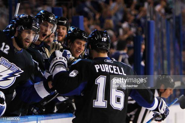 Teddy Purcell of the Tampa Bay Lightning celebrates his second period goal with teammates in Game Six of the Eastern Conference Finals against the...