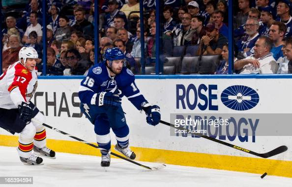 Teddy Purcell of the Tampa Bay Lightning controls the puck in front of Filip Kuba of the Florida Panthers during the third period of game at the...