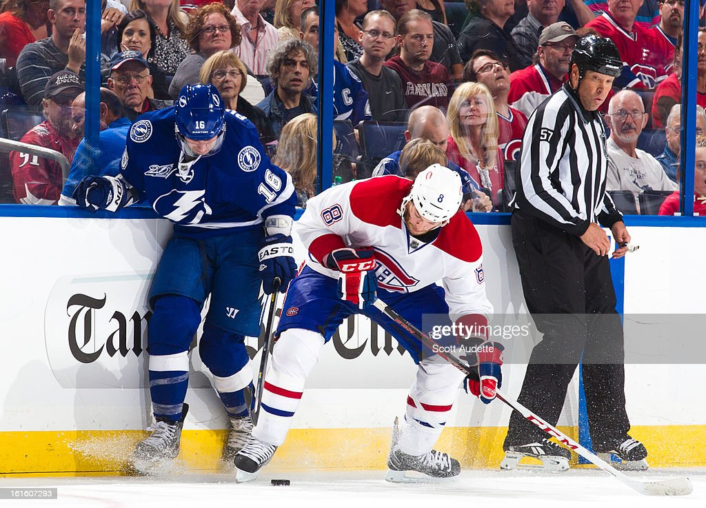 <a gi-track='captionPersonalityLinkClicked' href=/galleries/search?phrase=Teddy+Purcell&family=editorial&specificpeople=4537302 ng-click='$event.stopPropagation()'>Teddy Purcell</a> #16 of the Tampa Bay Lightning fights for control of the puck with <a gi-track='captionPersonalityLinkClicked' href=/galleries/search?phrase=Brandon+Prust&family=editorial&specificpeople=2221796 ng-click='$event.stopPropagation()'>Brandon Prust</a> #8 of the Montreal Canadiens during the third period of the game at the Tampa Bay Times Forum on February 12, 2013 in Tampa, Florida.