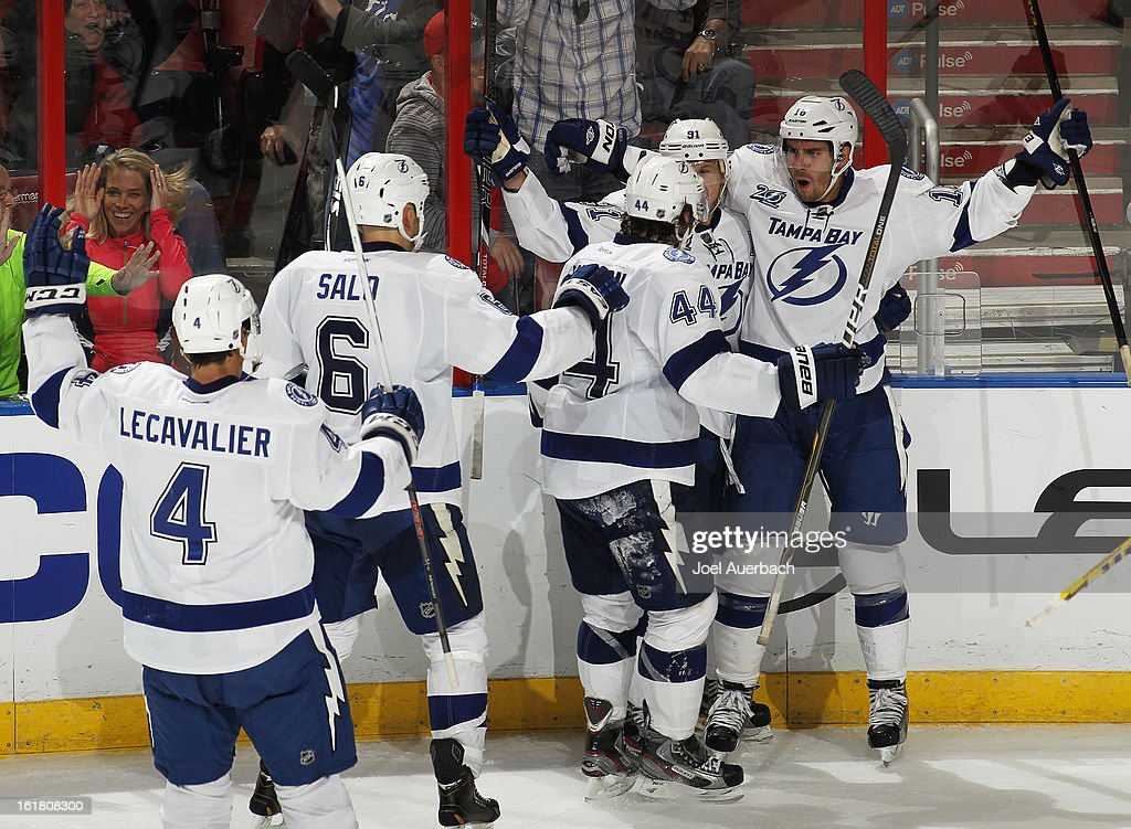 Teddy Purcell #16 of the Tampa Bay Lightning is mobbed by teammates after he scored a goal to tie the game late in the third period against the Florida Panthers at the BB&T Center on February 16, 2013 in Sunrise, Florida. The Lightning defeated the Panthers 6-5 in overtime.