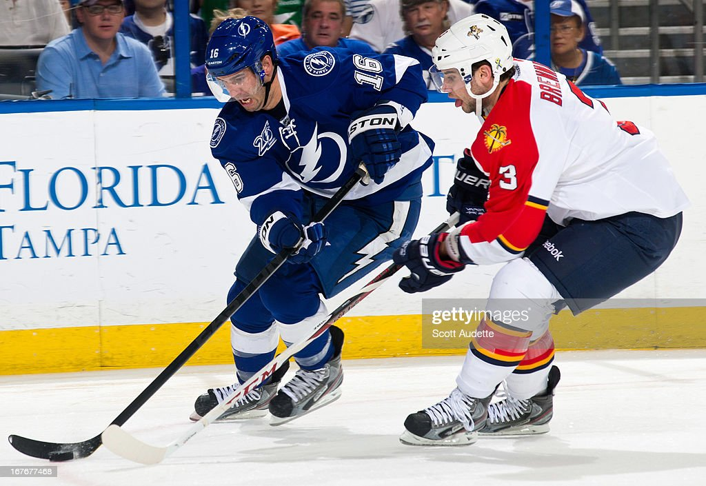 <a gi-track='captionPersonalityLinkClicked' href=/galleries/search?phrase=Teddy+Purcell&family=editorial&specificpeople=4537302 ng-click='$event.stopPropagation()'>Teddy Purcell</a> #16 of the Tampa Bay Lightning moves the puck ahead of T.J. Brennan #3 of the Florida Panthers during the first period of the game at the Tampa Bay Times Forum on April 27, 2013 in Tampa, Florida.