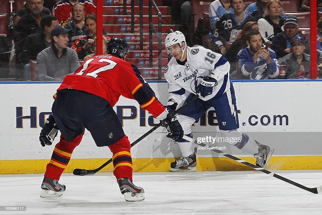 Teddy Purcell #16 of the Tampa Bay Lightning prepares to shoot the puck past Filip Kuba #17 of the Florida Panthers towards the net at the BB&T Center on March 12, 2013 in Sunrise, Florida.
