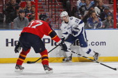 Teddy Purcell of the Tampa Bay Lightning prepares to shoot the puck past Filip Kuba of the Florida Panthers towards the net at the BBT Center on...
