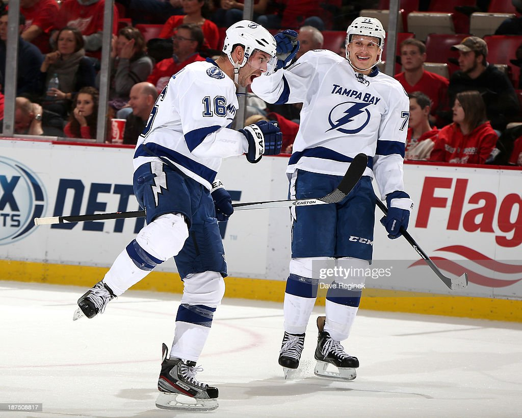Teddy Purcell #16 of the Tampa Bay Lightning pumps his fist after scoring an overtime goal to win the NHL game against the Detroit Red Wings at Joe Louis Arena on November 9, 2013 in Detroit, Michigan. Tampa Bay defeated Detroit 3-2 in OT.