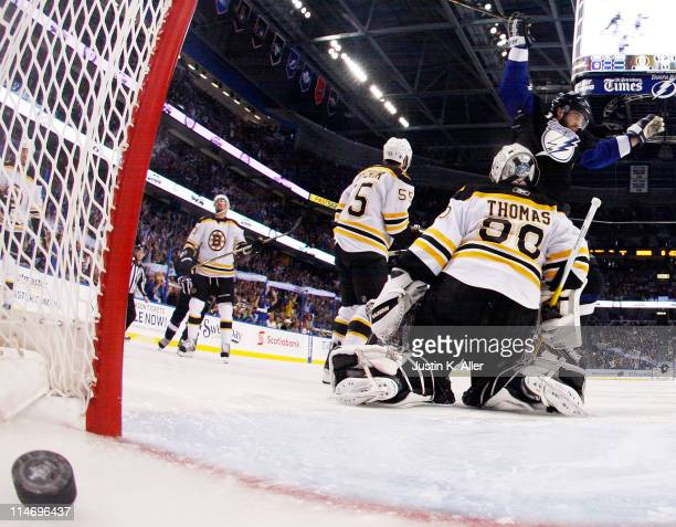 Teddy Purcell of the Tampa Bay Lightning scores a first period goal past Tim Thomas of the Boston Bruins in Game Six of the Eastern Conference Finals...