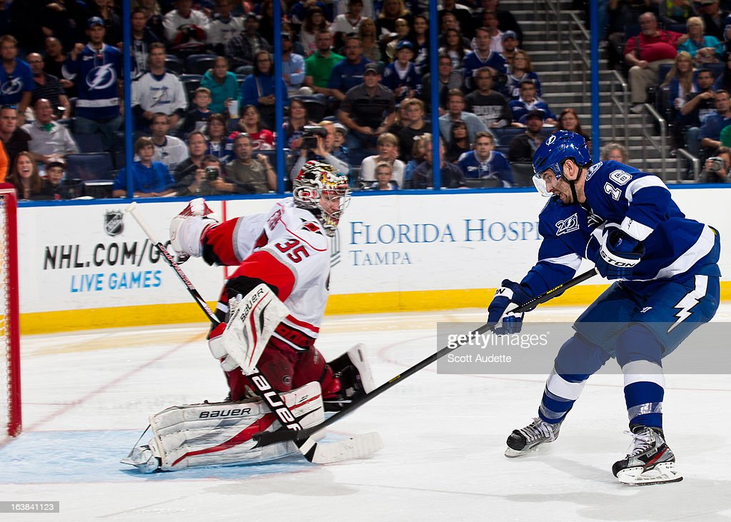 <a gi-track='captionPersonalityLinkClicked' href=/galleries/search?phrase=Teddy+Purcell&family=editorial&specificpeople=4537302 ng-click='$event.stopPropagation()'>Teddy Purcell</a> #16 of the Tampa Bay Lightning scores on a break away during the third period of the game against the Carolina Hurricanes at the Tampa Bay Times Forum on March 16, 2013 in Tampa, Florida.