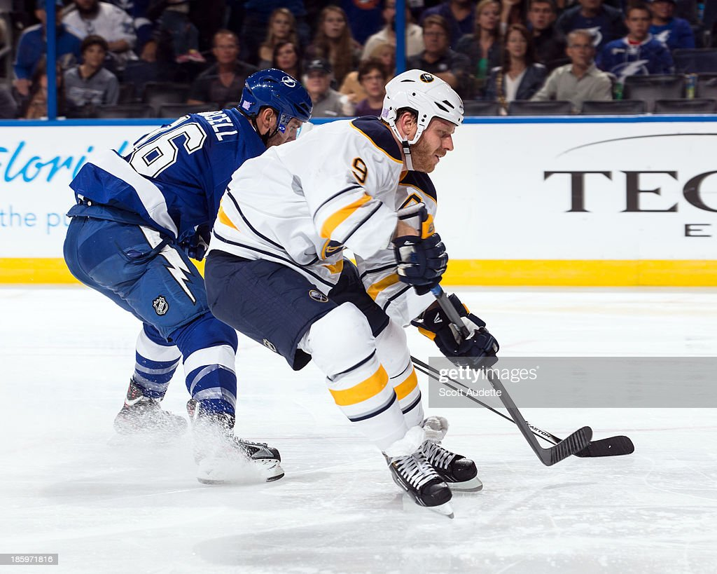 <a gi-track='captionPersonalityLinkClicked' href=/galleries/search?phrase=Teddy+Purcell&family=editorial&specificpeople=4537302 ng-click='$event.stopPropagation()'>Teddy Purcell</a> #16 of the Tampa Bay Lightning steals the puck from <a gi-track='captionPersonalityLinkClicked' href=/galleries/search?phrase=Steve+Ott&family=editorial&specificpeople=210616 ng-click='$event.stopPropagation()'>Steve Ott</a> #9 of the Buffalo Sabres during the second period at the Tampa Bay Times Forum on October 26, 2013 in Tampa, Florida.