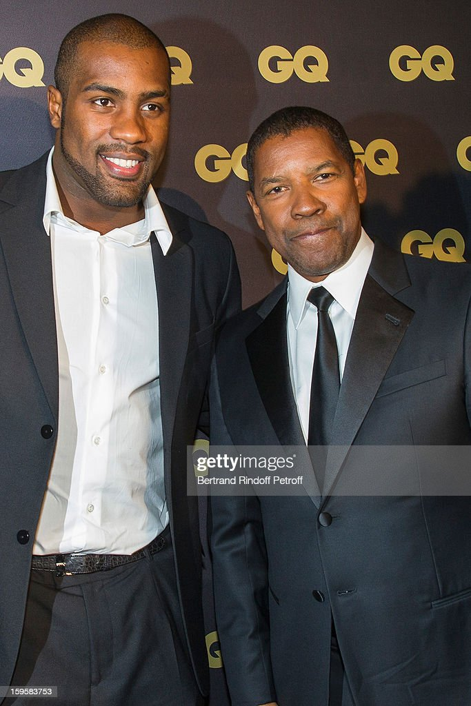 Teddy Riner (L) and Denzel Washington attend the GQ Men of the year awards 2012 at Musee d'Orsay on January 16, 2013 in Paris, France.