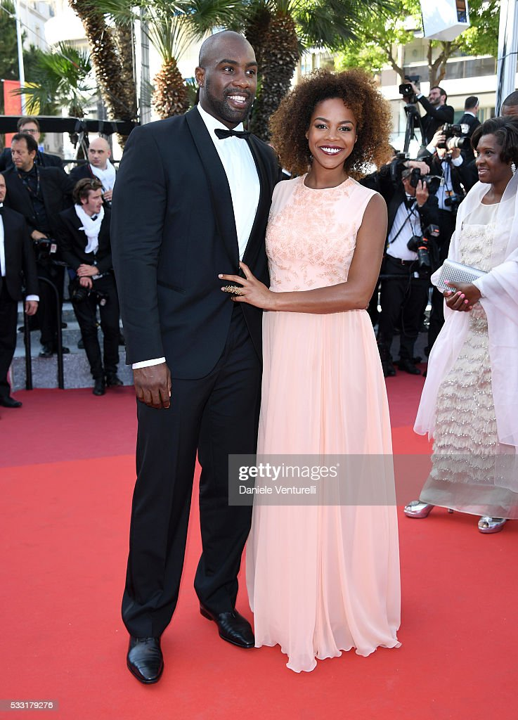 Teddy Riner and his partner Luthna attend the 'Elle' Premiere during the 69th annual Cannes Film Festival at the Palais des Festivals on May 21, 2016 in Cannes, France.