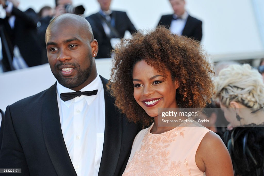 Teddy Riner and his partner Luthna Lors attend the 'Elle' Premiere during the 69th annual Cannes Film Festival at the Palais des Festivals on May 21, 2016 in Cannes, France.
