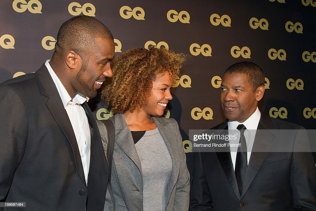 Teddy Riner, his companion Luthna and and Denzel Washington attend the GQ Men of the year awards 2012 at Musee d'Orsay on January 16, 2013 in Paris, France.