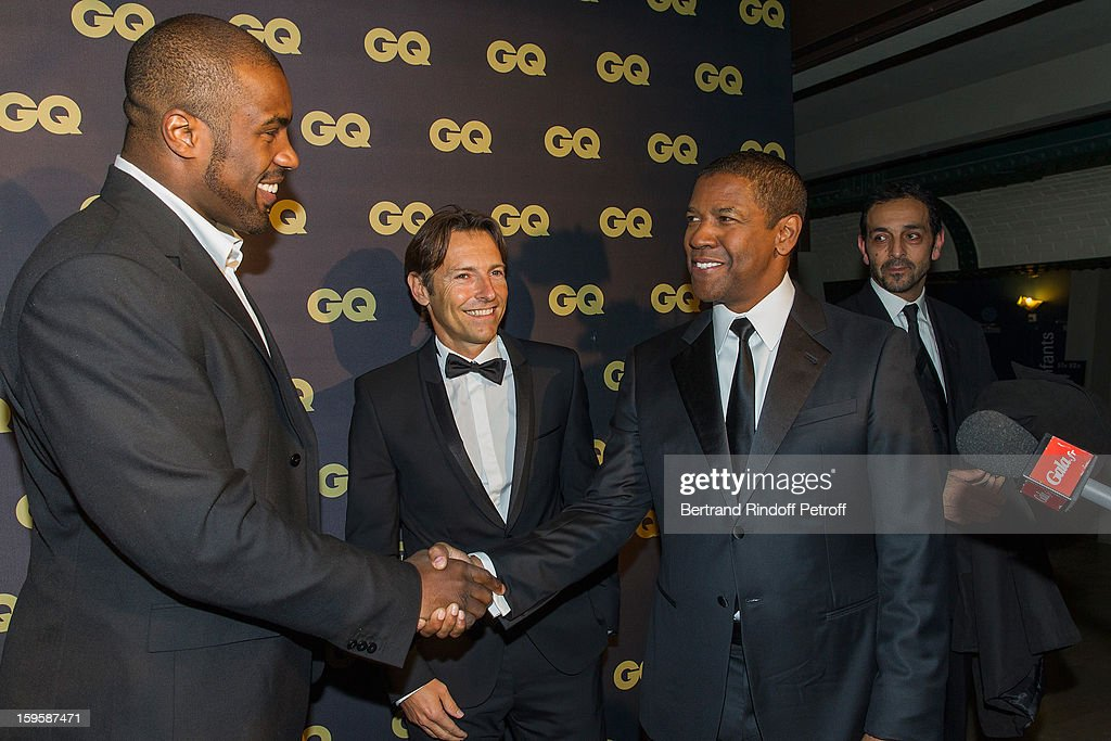 Teddy Riner, Marc Le Mat, Managing Director Hugo Boss France, and Denzel Washington attend the GQ Men of the year awards 2012 at Musee d'Orsay on January 16, 2013 in Paris, France.