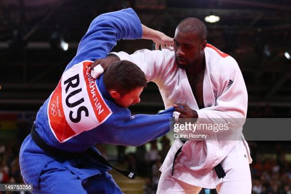 Teddy Riner of France and Alexander Mikhaylin of Russia compete in the Men's 100 kg Judo on Day 7 of the London 2012 Olympic Games at ExCeL on August...