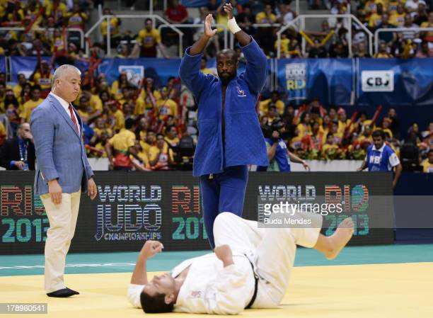 Teddy Riner of France celebrates a victory against Rafael Silva of Brazil in the 100 kg final category during a World Judo Championships at Gymnasium...