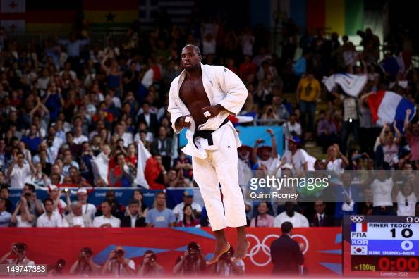 Teddy Riner of France celebrates his win over SungMin Kim of Korea in the Men's 100 kg Judo on Day 7 of the London 2012 Olympic Games at ExCeL on...