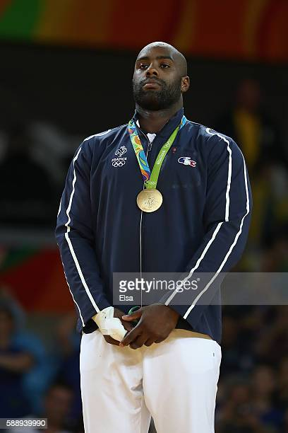 Teddy Riner of France celebrates on the podium after defeating Hisayoshi Harasawa of Japan during the Men's 100kg Judo Gold Medal contest on Day 7 of...